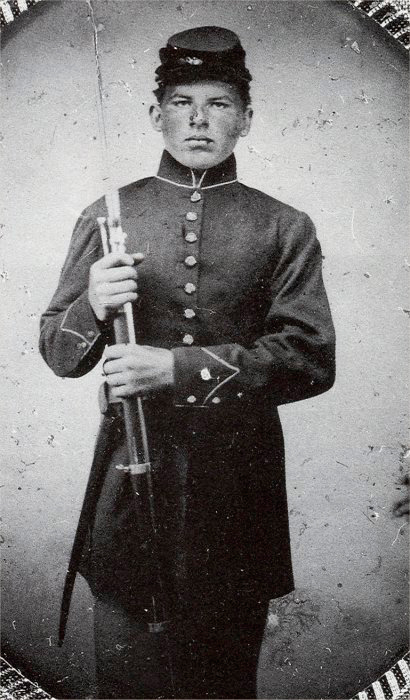 William Young, Co. G, 24th Michigan Infantry, another of the 24th Michigan's youngest members. This image gives us an idea of how 16-year-old Abner Delos Austin might have appeared in the typical Iron Brigade frock coat but prior to receiving his black Hardee hat in March of 1863 (Source: Ray Russell).
